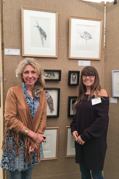 Mandy Shepherd with me and my painted feathers at TWASI 2018
