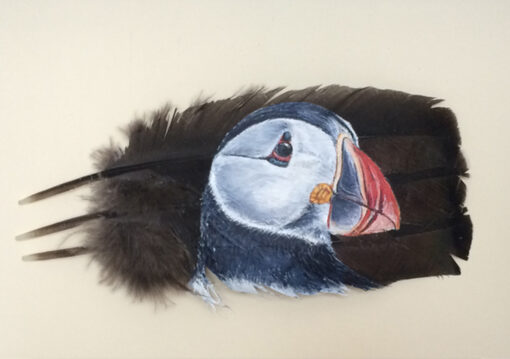 'Is This My Best Side?' Puffin painted on feathers by The Feather Lady